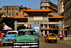Classic Cars in La Havana`s China Town. Picture of classic old cars from Cuba on the streets of La Havana in Cuba during a nice summer`s day with a chinese arch royalty free stock images