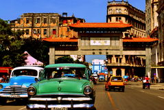 Classic Cars in La Havana`s China Town. Picture of classic old cars from Cuba on the streets of La Havana in Cuba during a nice summer`s day with a chinese arch stock photo