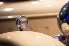 Classic cars. Lights close-up of the first part of Stock Images