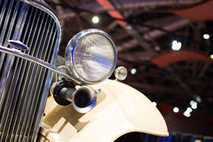 Classic cars. Lights close-up of the first part of Stock Photo