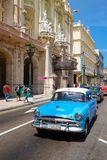 Classic cars next to the Great Theater and famous hotels in Old Havana. HAVANA,CUBA - MARCH 16,2018 : Classic cars next to the Great Theater and famous hotels in royalty free stock photo
