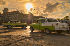 Classic cars in Old Havana illuminated at sunset royalty free stock photography