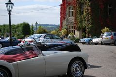 Classic Cars outside Fosse Manor, Stow-on-the-Wold, Gloucestershire, UK stock photography