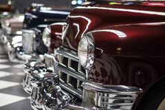 Classic Cars In A Row. Classic american cars into the garage Stock Image