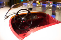 Classic cars. Steering wheel close-up of the first part of Stock Photography