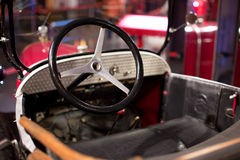 Classic cars. Steering wheel close-up of the first part of Royalty Free Stock Photography