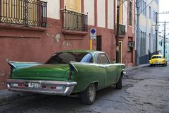 Classic cars in street of Santiago de Cuba Stock Photo
