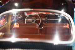 Classic cars. Classic vintage car interior with steering wheel closeup Stock Photography