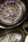 Classic cars. Wheel close-up of the first part of Stock Photos
