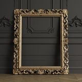 Classic carved mirror frame mockup with copy space. Classic carved gilded mirror frame mockup with copy space. Black walls with ornated mouldings. Floor parquet stock illustration