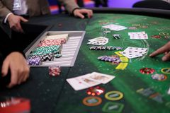 Classic casino blackjack table with chips and cards. Classic casino blackjack table with dealer, client, chips and cards Royalty Free Stock Image