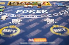 A classic casino poker table. Classic casino poker table close-up shot with some chips on it Stock Photography