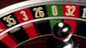 Classic casino roulette spinning, dealer takes the white ball, close up stock video footage
