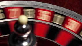 Classic casino roulette wheel, on black, ball white stock video