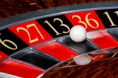 Classic casino roulette wheel with black sector thirteen 13. And white ball and sectors 6, 27, 36, 11 stock photo