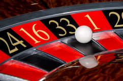 Classic casino roulette wheel with black sector thirty-three 33. And white ball and sectors 24, 16, 1, 20 stock photography