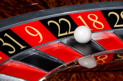 Classic casino roulette wheel with black sector twenty-two 22. And white ball and sectors 31, 9, 18, 29 royalty free stock image