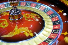 Classic casino roulette wheel with Chinese ornaments stock photos