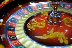 Classic casino roulette wheel with Chinese ornaments stock photography