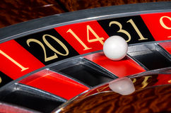 Classic casino roulette wheel with red sector four. Teen 14 and white ball and sectors 1, 20, 31, 9 stock images