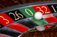 Classic casino roulette wheel with sector zero. And white ball Stock Photo