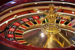 Classic casino roulette wheel and  table. A classic casino roulette wheel spinning still shot Stock Images
