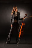 Classic cello and girl. Studio isolated shot Royalty Free Stock Images
