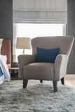 Classic chair with blue pillow Royalty Free Stock Photography