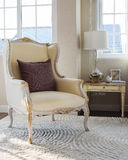 Classic chair with brown pillow on carpet in vintage bedroom Royalty Free Stock Images