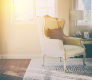 Classic chair with brown pillow on carpet in vintage style bedroom Stock Images