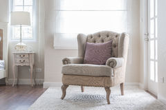 Classic chair on carpet with pillow Stock Image