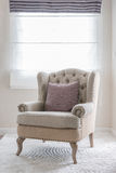 Classic chair on carpet with pillow Royalty Free Stock Photos