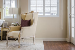 Classic chair on carpet with pillow in bedroom Royalty Free Stock Photos