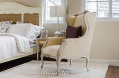 Classic chair on carpet with pillow in luxury bedroom Royalty Free Stock Image