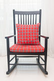 Classic chair with red plaid pillow Royalty Free Stock Photo