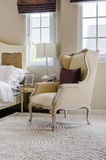 Classic chair style on carpet with pillow in luxury bedroom Royalty Free Stock Photos