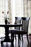 Classic chairs. Wooden black classic chairs and table Royalty Free Stock Images