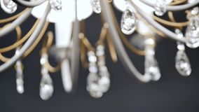 Classic chandelier isolated on grey background stock video