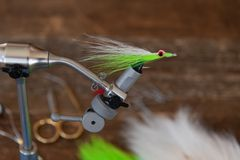 Classic chartreuse color Clouser Minnow streamer fly. With red eyes ready to see action stock image