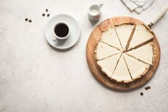 Classic Cheesecake. Cheesecake New York and coffee on white background, top view, copy space stock images