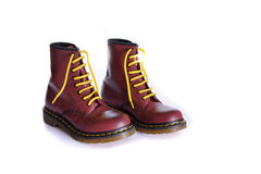 Classic cherry red oxblood lace-up boots with yellow laces Royalty Free Stock Photos