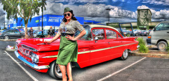 Classic Chevy Bel Aire with woman in army uniform Stock Photo