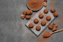Classic chocolate truffles on dark concrete background. Or table stock photos