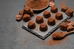 Classic chocolate truffles on dark concrete background. Or table royalty free stock images