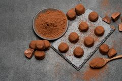 Classic chocolate truffles on dark concrete background. Or table stock images
