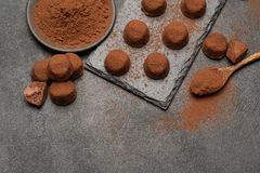 Classic chocolate truffles on dark concrete background. Or table royalty free stock photography