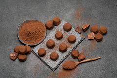 Classic chocolate truffles on dark concrete background. Or table stock photo