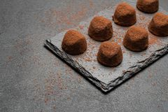 Classic chocolate truffles on dark concrete background. Or table royalty free stock photos