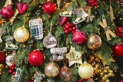Classic Christmas background of balls with decorated tree. New year decor royalty free stock photography