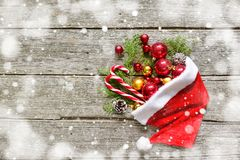 Classic christmas composition balls, toys, candy, fir branches on vintage wooden background Royalty Free Stock Images